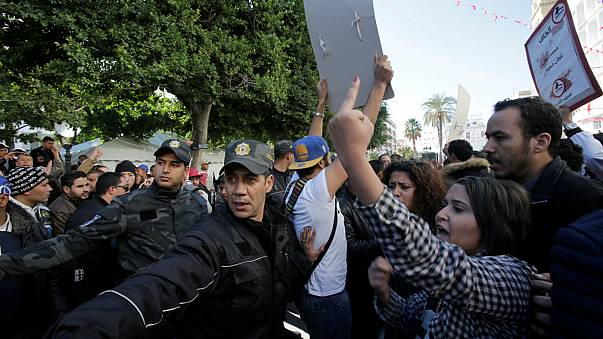 Tunisia Police and people react during demo the 7th anniversary