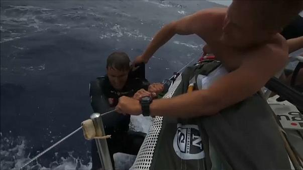 Sailor Alex Gough rescued by a shipmate after falling into the Pacific