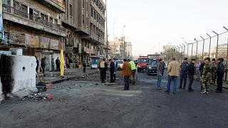 Iraq: dozens killed as suicide bombers hit Baghdad market