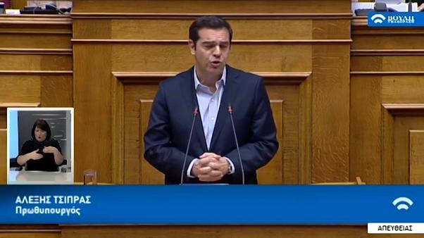 Greek lawmakers approve more reforms in bid to end years of bailouts