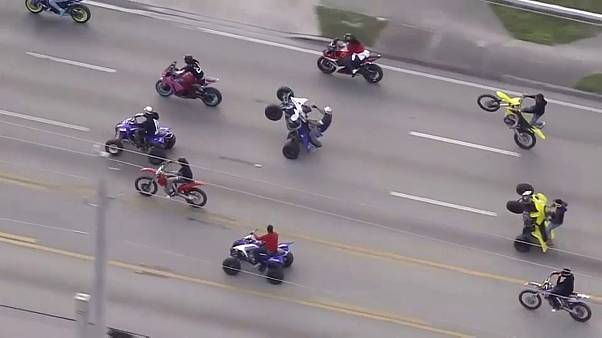 'Wheels Up, Guns Down' ride through Miami