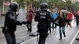 A woman yells at riot police near a a polling station