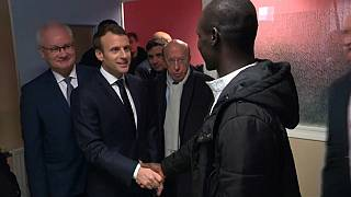 French president Emmanuel Macron meets African migrant in Calais