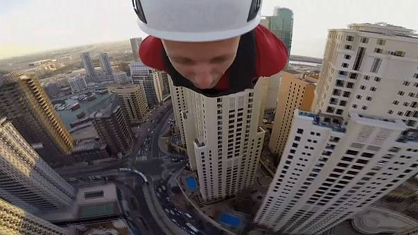 Daredevils ride the world's 'longest and fastest urban zip line'