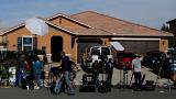 New media gather outside the home of David Allen
