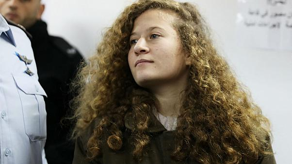 Palestinian teen Ahed Tamimi enters a military courtroom at Ofer Prison