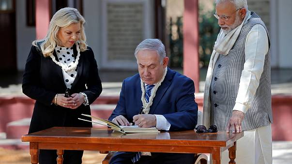 Israeli Prime Minister Netanyahu writes a message in the visitor's book