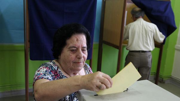 A woman casts her vote at a polling station during parliamentary elections