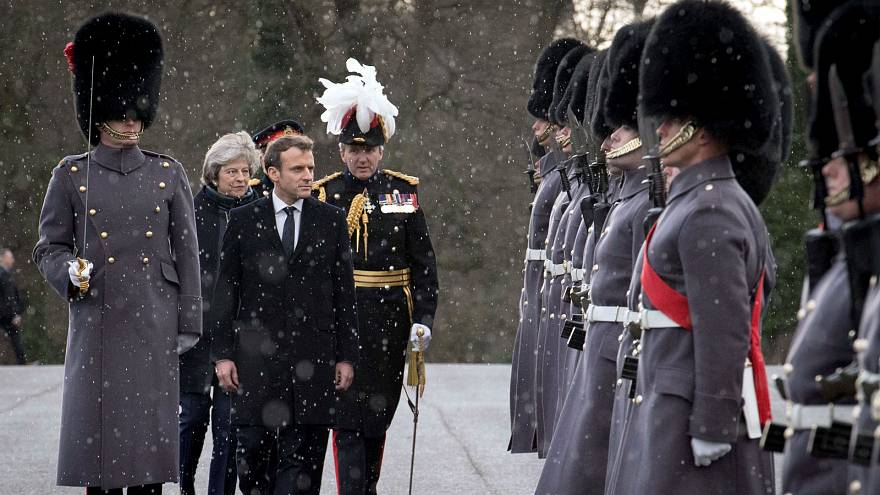French President Emmanuel Macron inspects troops at Sandhurst