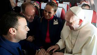 Pope marries cabin crew couple on Chile flight