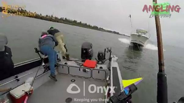 A still from the dramatic video of the fishermen's narrow escape