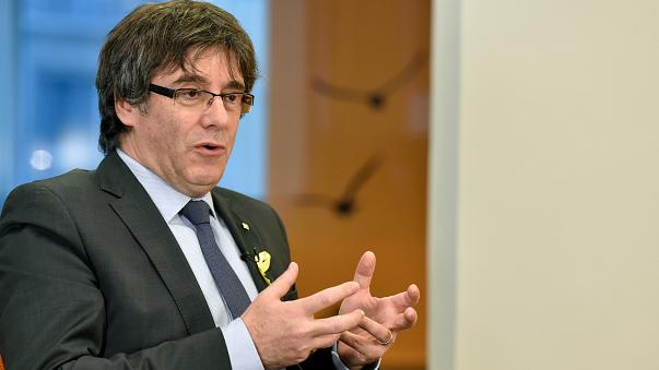 Former Catalan president Carles Puigdemont attends an interview with Reuter