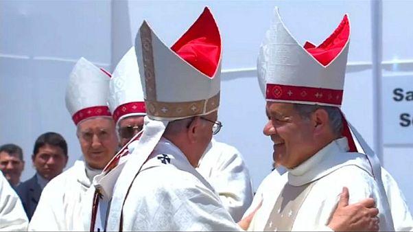 The Pope hugs Bishop Juan Barros during mass