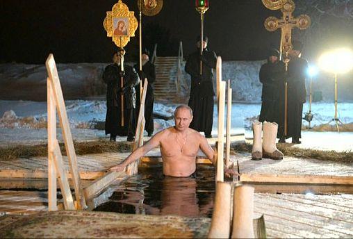 Putin takes traditional Epiphany dip in icy lake