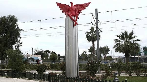 Protesters tear down red-winged 'Satan' statue in Athens