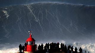 Surfer Sebastian Steudtner drops in on a large wave at Nazare, Portugal.