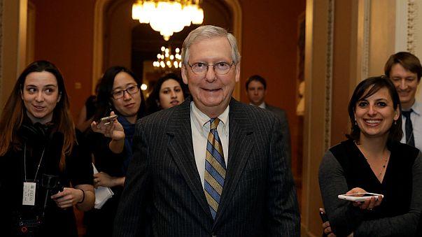 Senate majority leader Mitch McConnell walks to the Senate chamber.