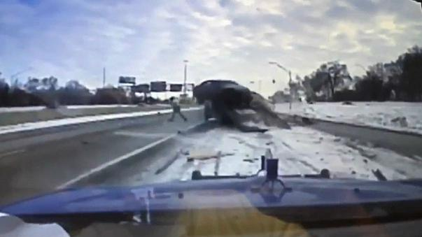 A breakdown truck driver has a lucky escape on a US highway.