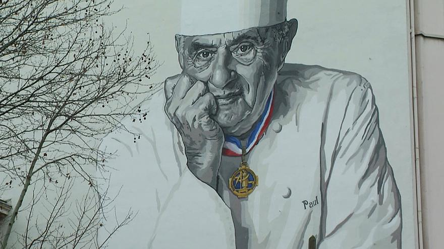 Paul Bocuse looks down fondly on Lyon from mural outside Les Halles