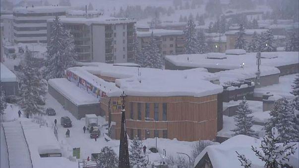 World Economic Forum in Davos battles snow... and awaits Trump