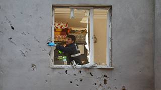 Turkish police examine house hit by shelling from Syria