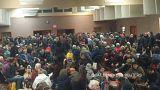 People wait at Tofino, British Columbia, Canada during the tsunami alert