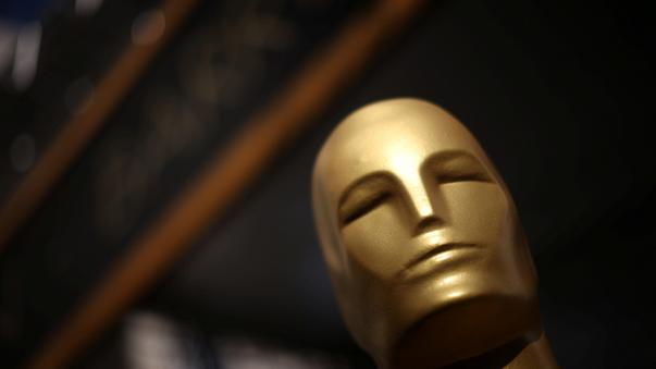 An Oscar statue is seen outside the Dolby Theatre as preparations continue
