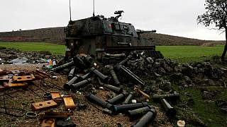 Empty shells are seen next to a Turkish army