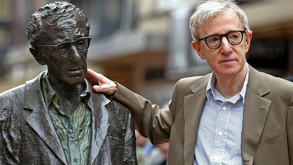 U.S. director Woody Allen poses with a statue of himself in Oviedo