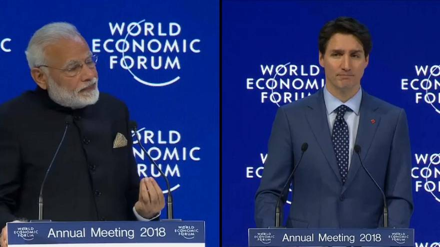 Modi and Trudeau defend free trade at Davos