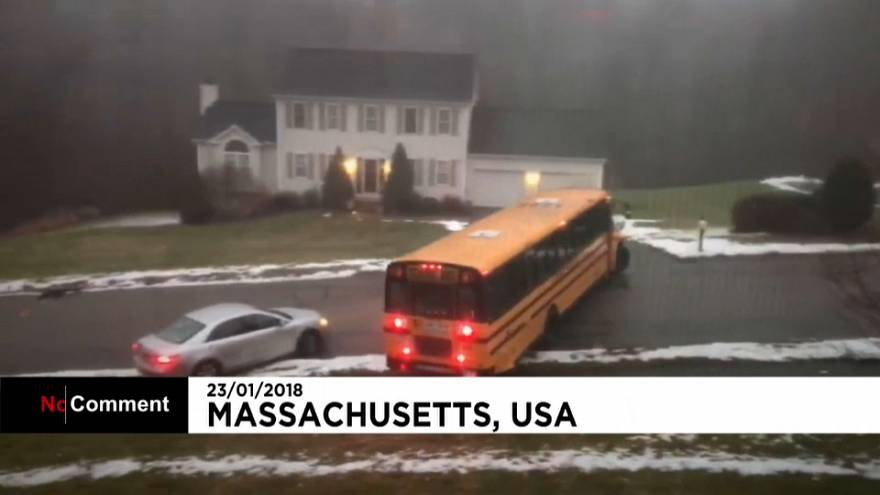 Eyewitness films school bus skidding down an icy hill in Massachusetts