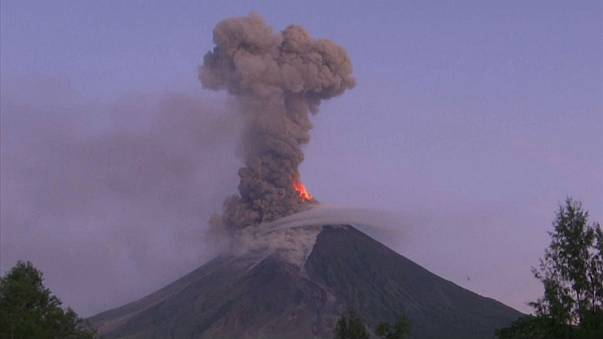 Watch: erupting volcano spews lava and ash into the sky
