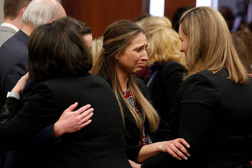 Prosecutor Angela Povilaitis embraces victim Kyle Stephens after the sentencing of Larry Nassar,