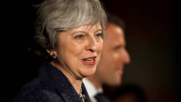 Tech firms must do more to protect online users, says May