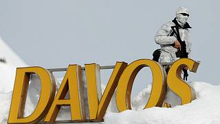 Swiss police officer observes surrounding area from roof Davos
