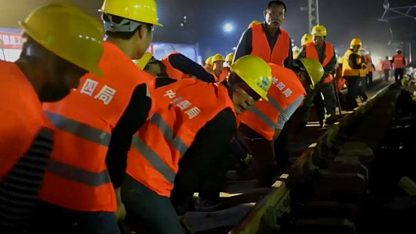 Full steam ahead: Chinese workers lay new railway track in just hours
