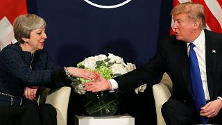 US President Trump shakes hands with UK Prime Minister Theresa May in Davos