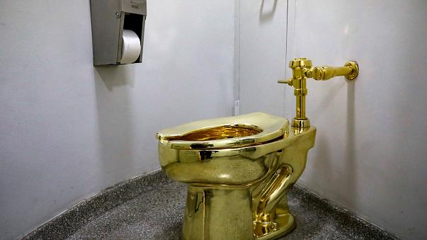 """Maurizio Cattelan's """"America,"""" a fully functional solid gold toilet is seen"""