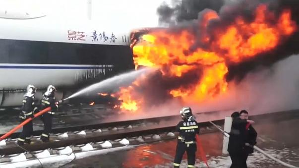 Fire crews tackle fire on a high speed train in China's Anhui province