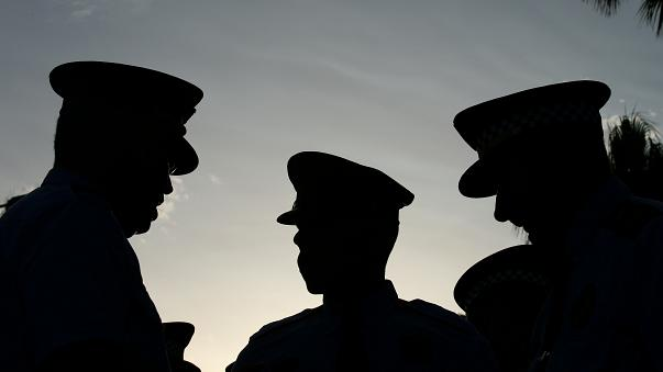 Mossos d'Esquadra officers speak before a rally against the Barcelona and C