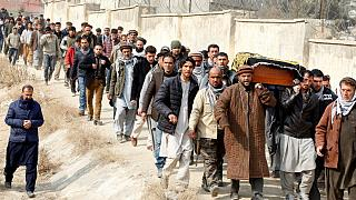 Afghan men carry the coffin of one of the victims