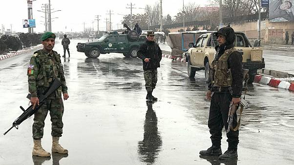 Afghan security forces stand near the Marshal Fahim military academy