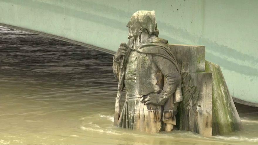 Partially submerged statue in Paris' swollen Seine river