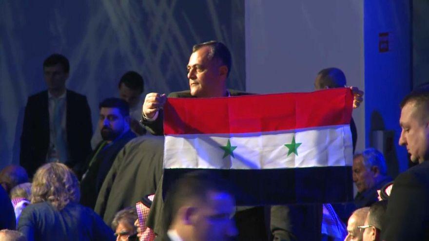 Syrian delegate unfurls Syrian flag at peace talks in Sochi