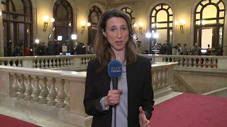 Catalan parliament suspends session to invest Puigdemont