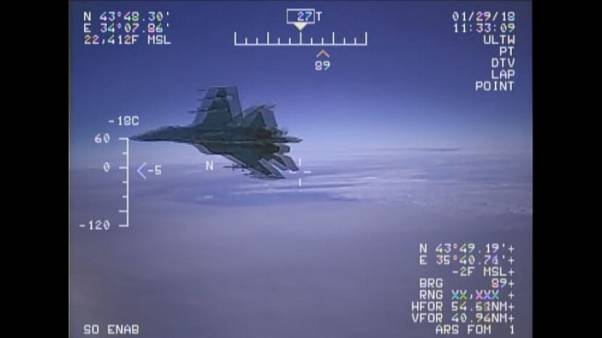 Watch: Dramatic moment a Russian jet 'unsafely' intercepts US naval plane