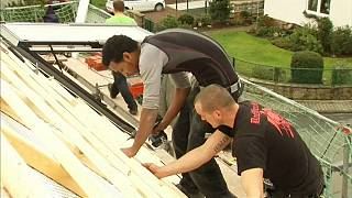 A refugee from Eritrea is trained in roofing in Germany