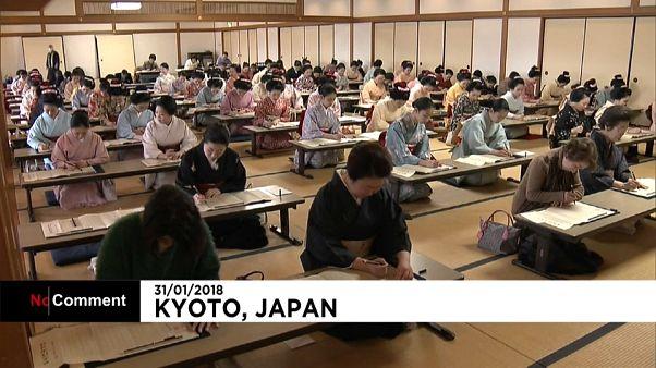 Geisha girls in Kyoto copy Buddhist sutras