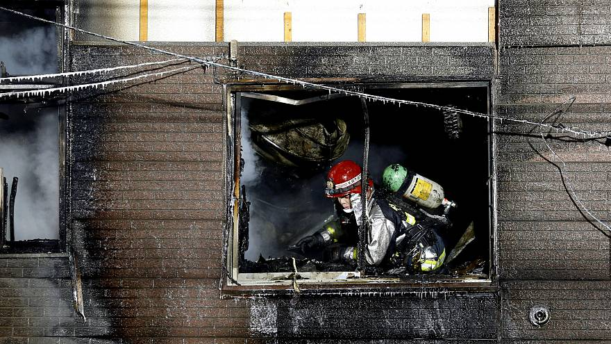 A firefighter inspects damage at a senior citizens facility in Sapporo