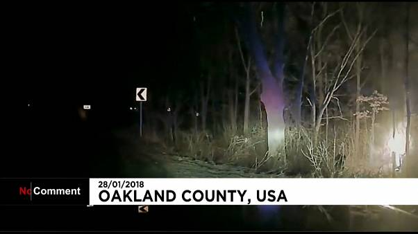 Man rescued from burning car by police in the US